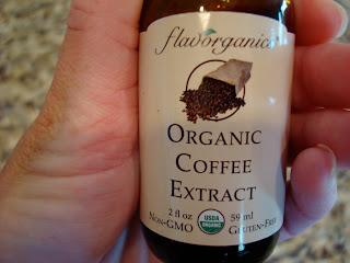 Hand holding Organic Coffee Extract