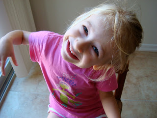 Young girl with head to the side smiling