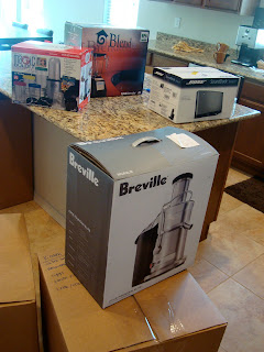 Various kitchen appliances in boxes