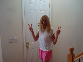 Lady standing in front of door giving double peace signs
