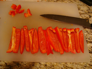 Sliced red peppers on cutting board