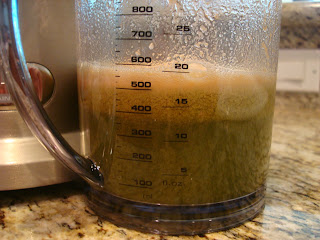 Measuring portion of juicer showing the juice that has been made