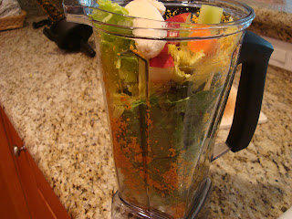 Mixed vegetables and fruit in blender