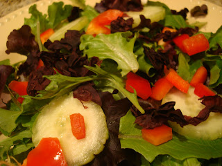 Mixed vegetables and greens topped with Dulse flakes in shallow white bowl