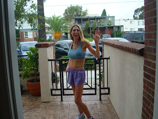 Woman in running attire in front of gate