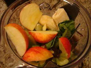 Overhead of blender full of vegetables and fruit