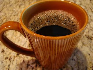 Brown mug of brewed coffee