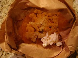 Popped popcorn in paper bag