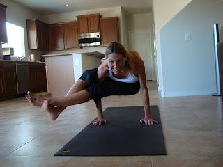 Woman doing Astavakrasana yoga pose