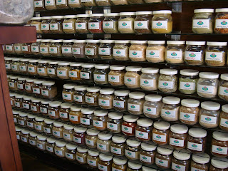 Shelves filled with containers of Chinese herbs