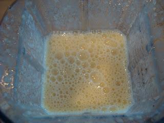 Blended smoothie in blender overhead