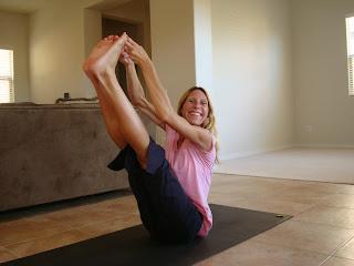 Woman doing Ubhaya Padungusthasana yoga pose