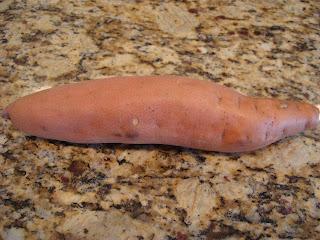 Long skinny sweet potato on countertop