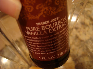 Hand holding bottle of Trader Joe's Pure Bourbon Vanilla Extract