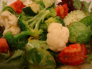 Mixed greens with vegetables in dressing