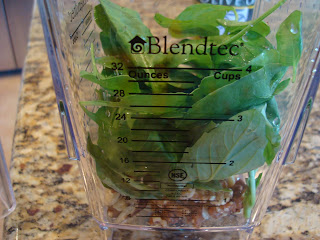 Spinach, basil, lemon juice, olive oil and walnuts added to blender