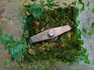 Overhead of pulsed pesto ingredients in blender