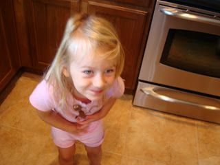 Young girl dressed in pink dancing in kitchen