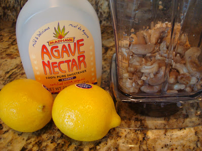 Agave, soaked cashews and two lemons on countertop