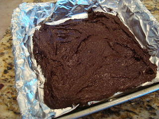 Thin Mint Fudge spread into foil lined pan