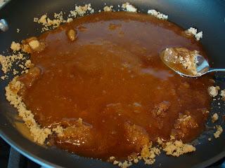 Spoon stirring Vegan Banana Foster ingredients in pan while melting