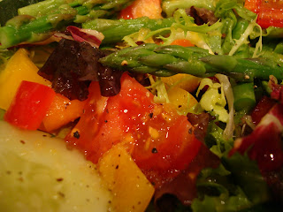 Greens with mixed vegetable topped with dressing