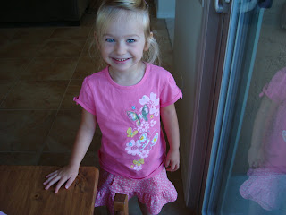 Smiling young girl wearing all pink