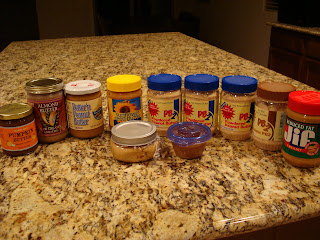 Countertop full of various nut butters