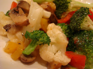 Up close of vegetables tossed with sauce