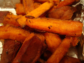 Close up of Sweet Potato Fries in foil lined pan