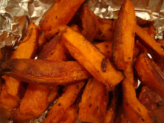 Sweet Potato fries after they are done roasting in foil lined pan