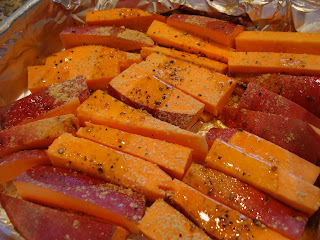 Sweet potatoes sliced into fry shape drizzled with oil, salt, pepper and ginger