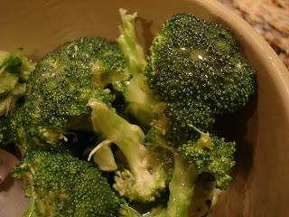Glazed broccoli in brown bowl