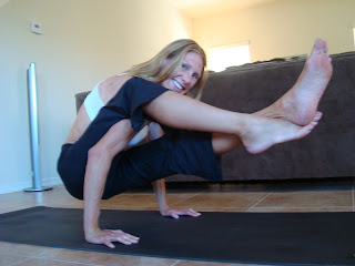 Woman doing Astavakrasana Variation yoga pose