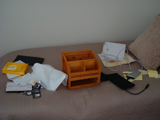 Contents of desk placed on bed