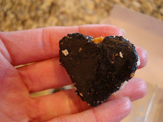 Hand holding a piece of heart shaped fudge