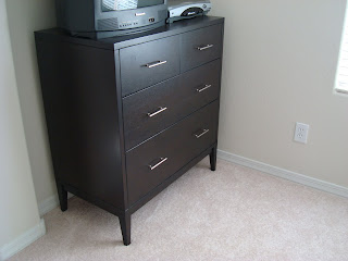 Dark colored dresser in room