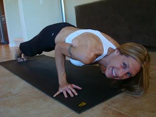 Woman doing Chaturanga Dandasana yoga pose