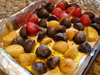Ginger Roasted Tri-Colored Potatoes on foil lined pan