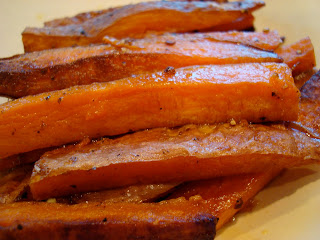 Stacked Sweet Potato Fries on white plate