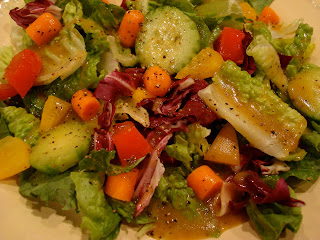Green salad with mixed vegetables and homemade dressing