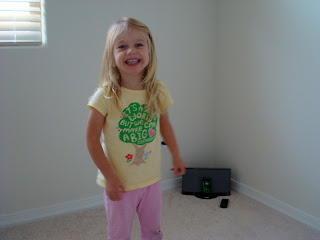 Young girl smiling standing listening to music