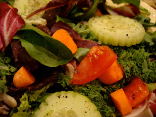 Up close of mixed green salad with vegetables