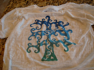 Tee with a Tree with an Om symbol in the middle of the tree