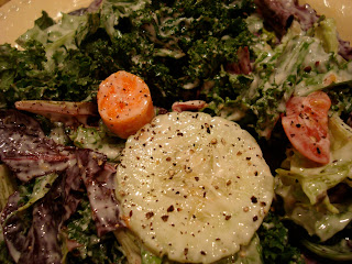"Up close of salad slathered in Creamy Tahini ""Cesar"" Inspired Vegan Dressing"