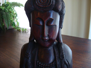 Close up of dark chocolate-colored wooden statue