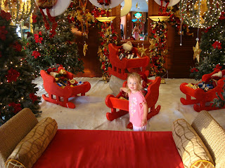 Young girl in open air lobby decorated in Christmas Theme