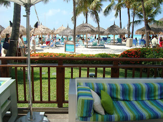 Outdoor seating at hotel with beach view