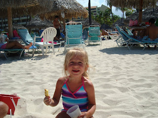 Young girl smiling playing on beach