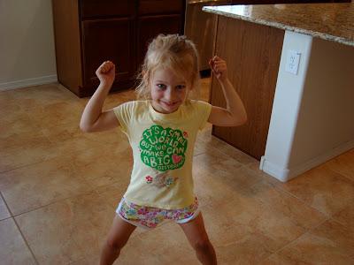Young girl flexing